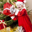 Little girl as Santa Claus with Christmas presents — Stock Photo #7587560