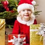 Santa Claus with Christmas presents — Stock Photo #7587562