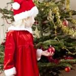 Little girl as Santa Claus — Stock Photo #7843036
