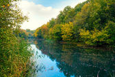 Blue river in autumn — Stock Photo