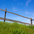 Wooden fence on grassland — Stock Photo #25461657