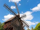 Windmill on blue sky background — Stock Photo