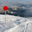 Red round sign on ski resort — Stock Photo