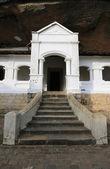 Eingang zum buddha felsentempel — Stockfoto