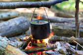 Kettle on campfire — Stock Photo