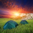 Tourists tents on mountain's meadow — Stock Photo #42481393