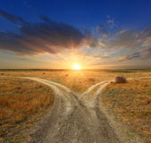 Fork roads on sunset background — Stock Photo