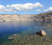 Lake in abandoned quarry — Stock Photo