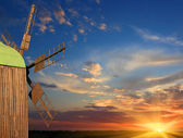 Windmill on sunset background — Foto Stock