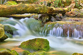 Small waterfall on mountain river — Stockfoto