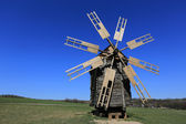 Old wooden windmill on meadow — Stock Photo
