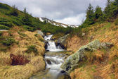 Nice waterfall in mountains — Stockfoto