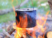 Tourist kettle among hot flame — Stock Photo