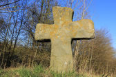 Old stone cross on meadow — Stock Photo