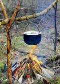 Tourist kettle on campfire — Stock Photo