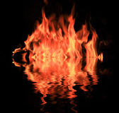 Fire in darkness with water reflection — Stock Photo