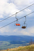 Ski lift in spring background — Stock Photo