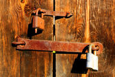 Locks on wooden door — Stock Photo