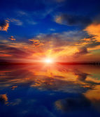 Sunset over water surface — Stock Photo