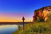 Cross near big lake — Stock Photo