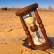 Hourglass on sand — Stock Photo #51684147