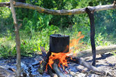 Tourist kettle on camp fire — Foto Stock