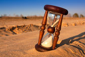 Hourglass in desert's sand — Stock Photo