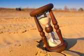 Hourglass on sand — Stock Photo