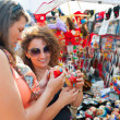 Female tourists choosing souvenirs — Stock Photo