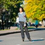 Girl roller-skating near Gorky Park — Stock Photo #13436791