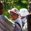 Schoolboys visit elephant feeding farm — Stock Photo