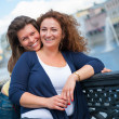 Two happy young beautiful women - Stockfoto