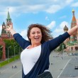Happy young woman tourist visiting Moscow — Stock Photo