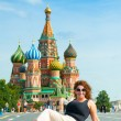 Happy young woman lying on Red Square in Moscow, Russia. — Stock Photo #15712355