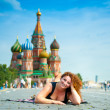 Happy young woman lying on Red Square in Moscow, Russia. — Stock Photo
