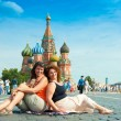 Happy young women visit Red Square — Stock Photo