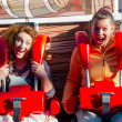 Women riding in the amusement park — Stock Photo