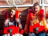 Women riding in the amusement park — Stock Photo