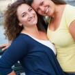 Two happy young beautiful women — Stock Photo #16215381