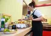 Waitress serving breakfast — Stock Photo