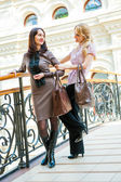 Two young women in a mall — Stock Photo