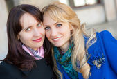 Two women portrait outdoors — Stock Photo