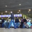 Stock Video: Passengers in the airport time-lapse