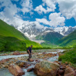Hikers group cross the mountain river — Stock Photo