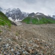 Glacier at the foot of the mountain Shkara — Stock Photo
