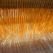 Stock Photo: Threads in old weaving loom
