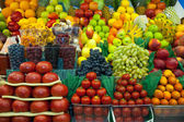 Lot of fresh fruits and vegetables for sale — Stock Photo