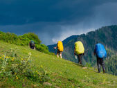 Young hikers trekking in Svaneti, — Stock Photo