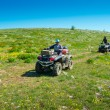 Couple ride on ATVs — Stock Photo #36097547