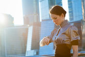 Business woman checking the time — Stock Photo